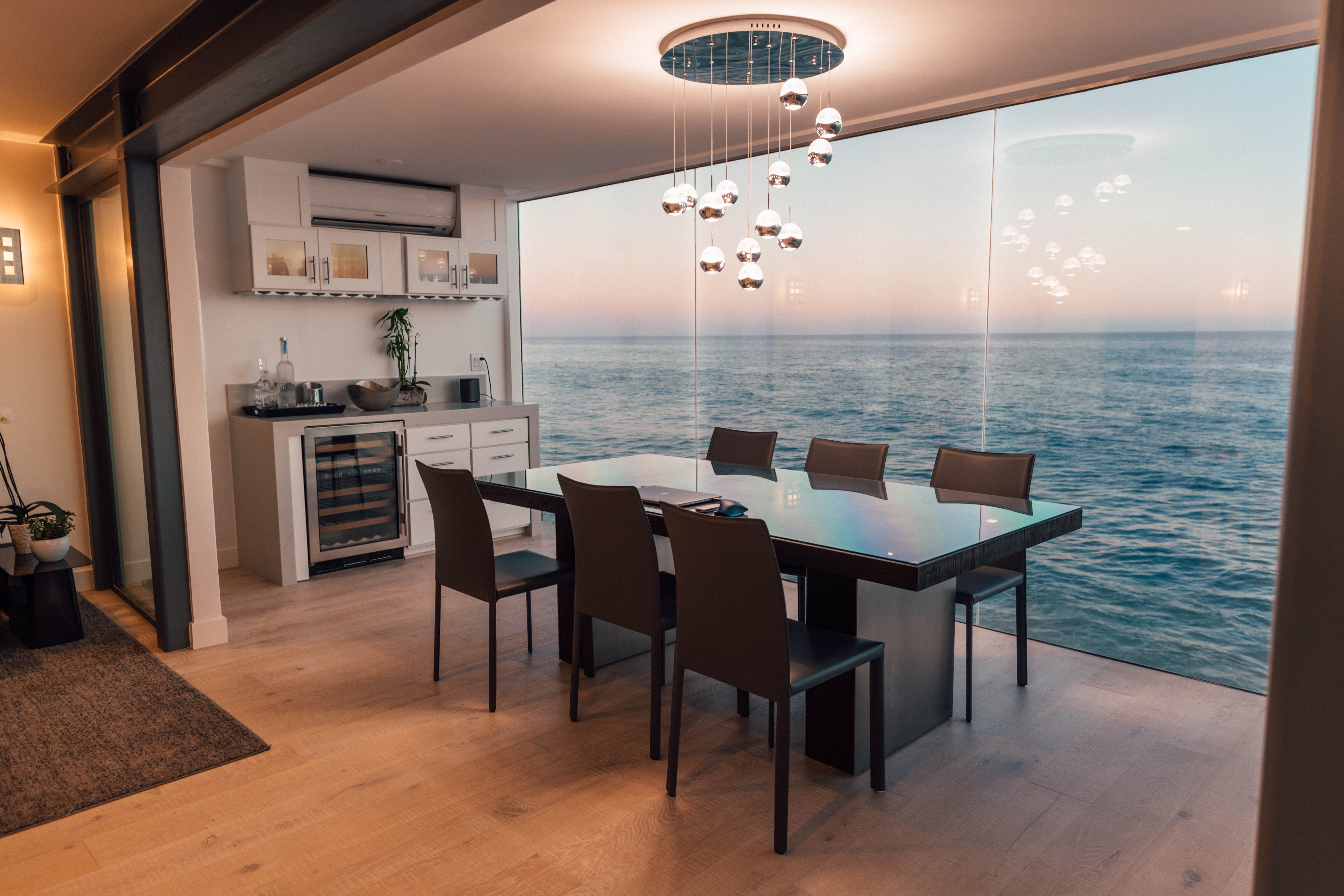 rented dining set in staged home with ocean backdrop