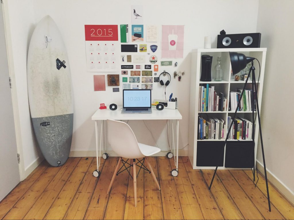 small home office with white chair, desk, and bookshelf - casaone