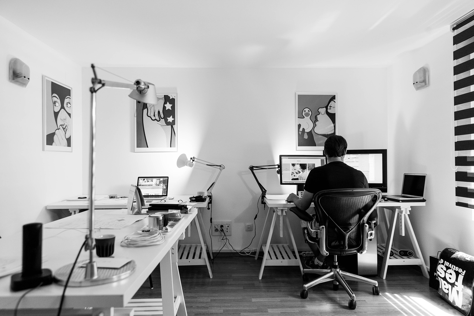 black and white image of man in home office - casaone