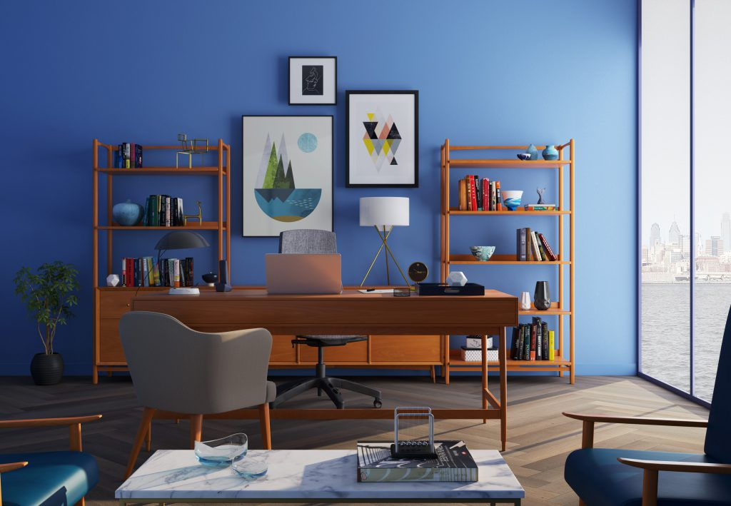 A wooden desk with a task chair & wooden bookshelves near a window - a perfect setting for remote work