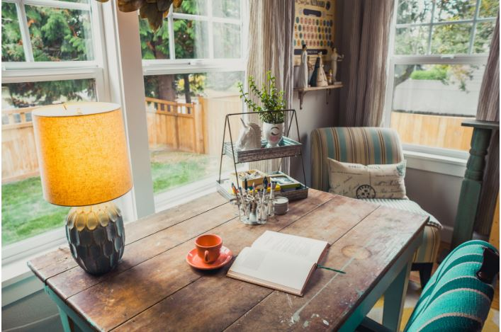 wooden table with a lamp & biophilia