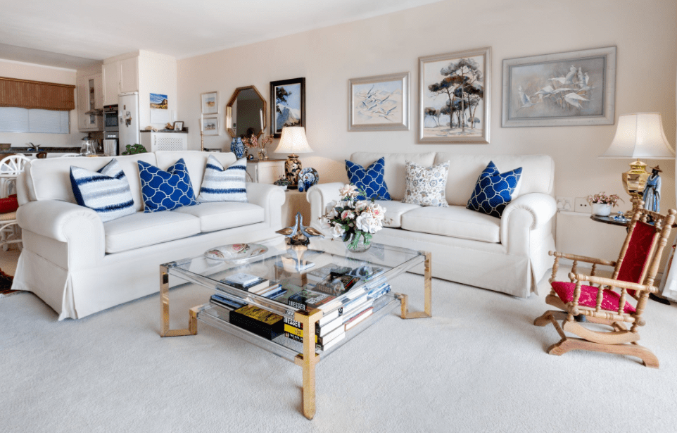 Well-decorated living room with a white couch