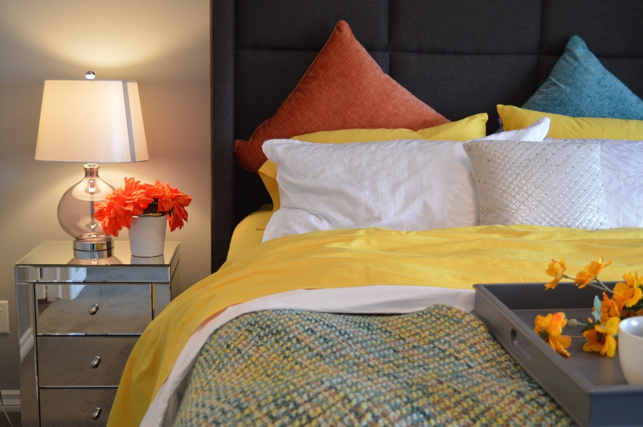 Table lamp on a metallic bedside table and bright room