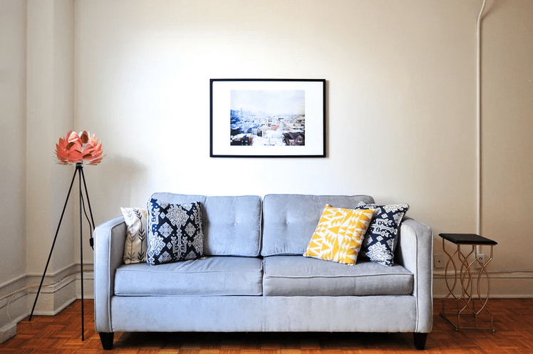 Small living room sofa with colorful cushions