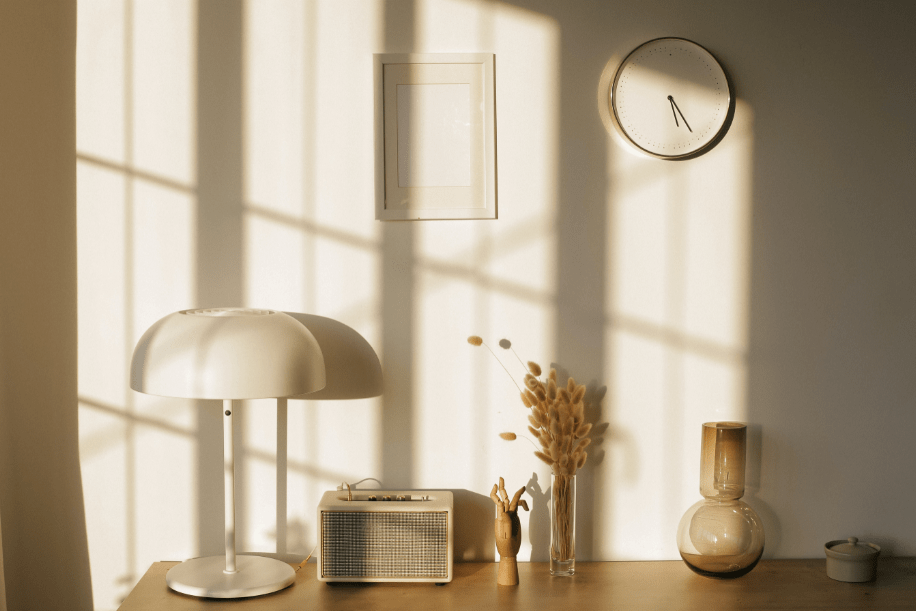 Sunlight reflecting off a wall in a room with neutral decor