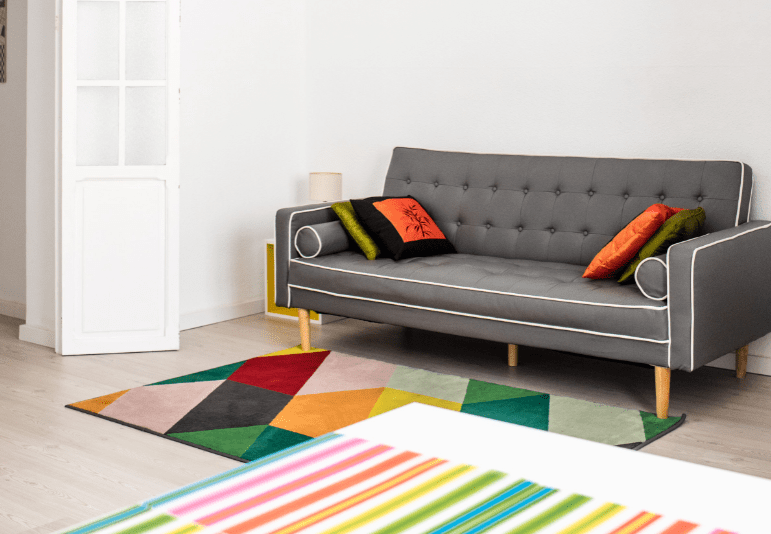 Living room with sofa and bright rug