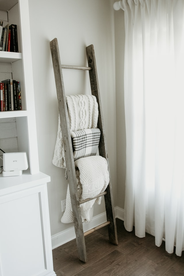 A towel rack made from a ladder