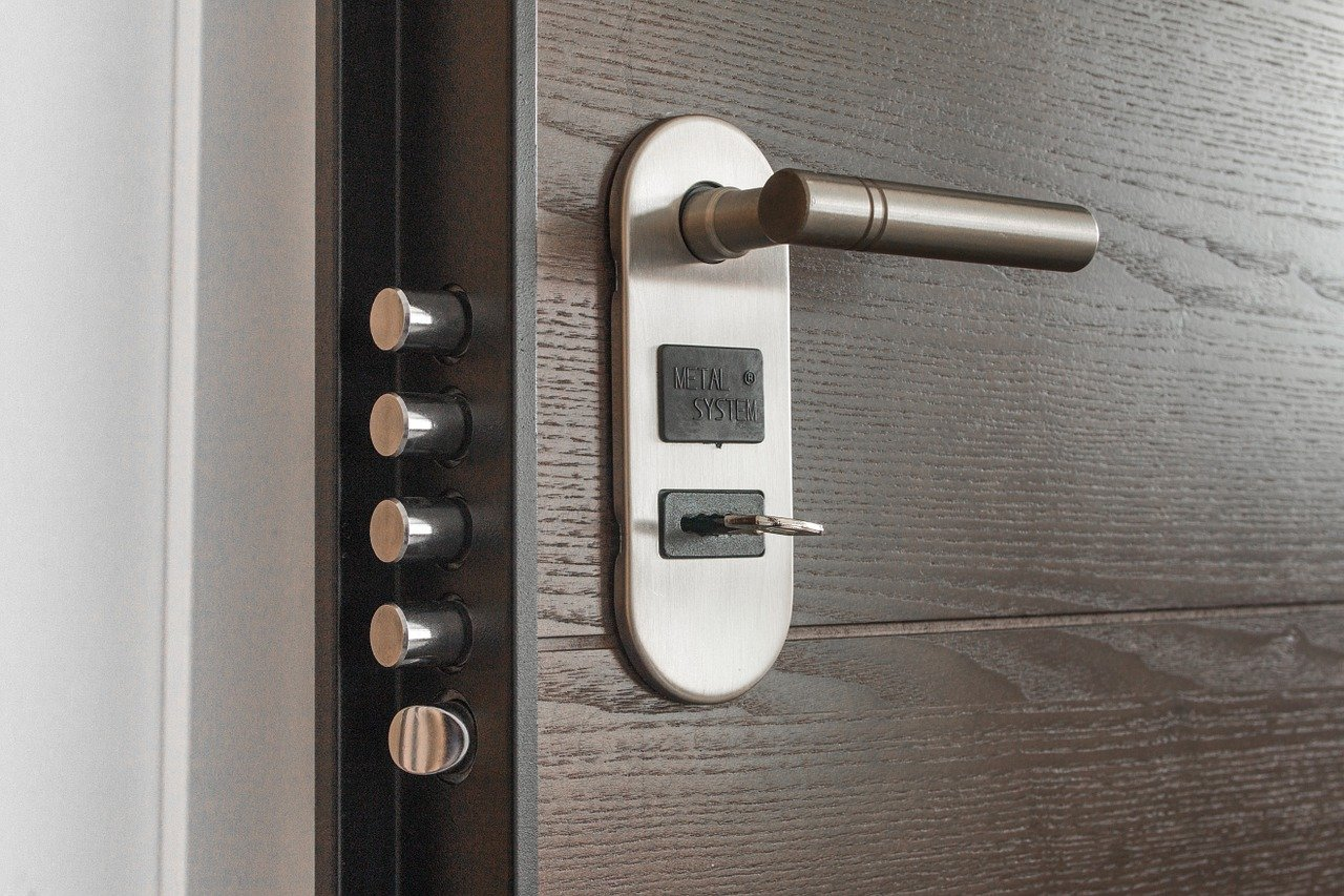Door with multiple safety locks