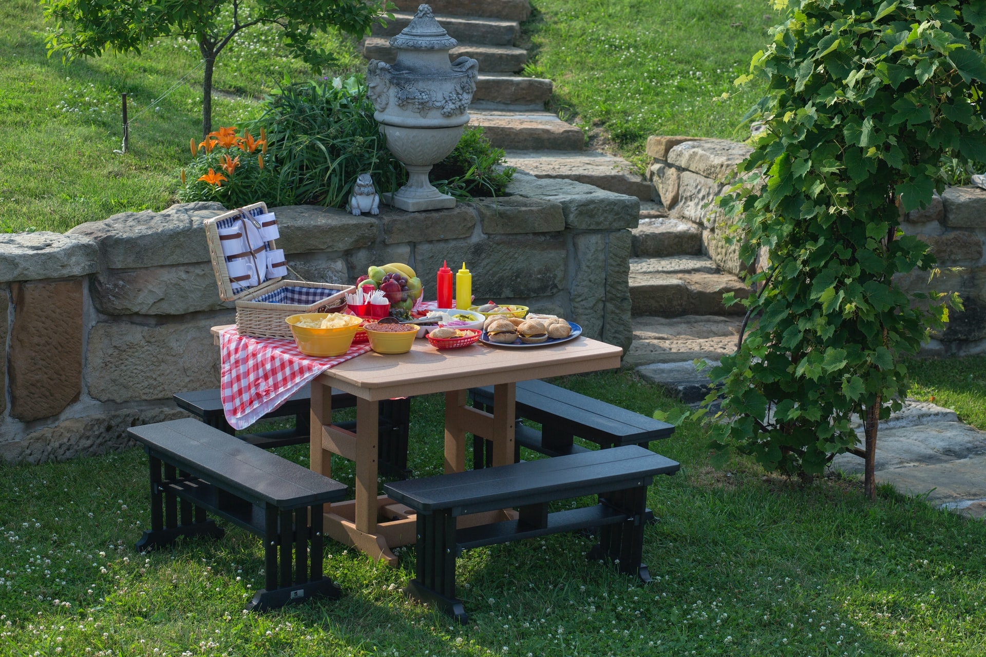 Small benches picnic set up in the backyard